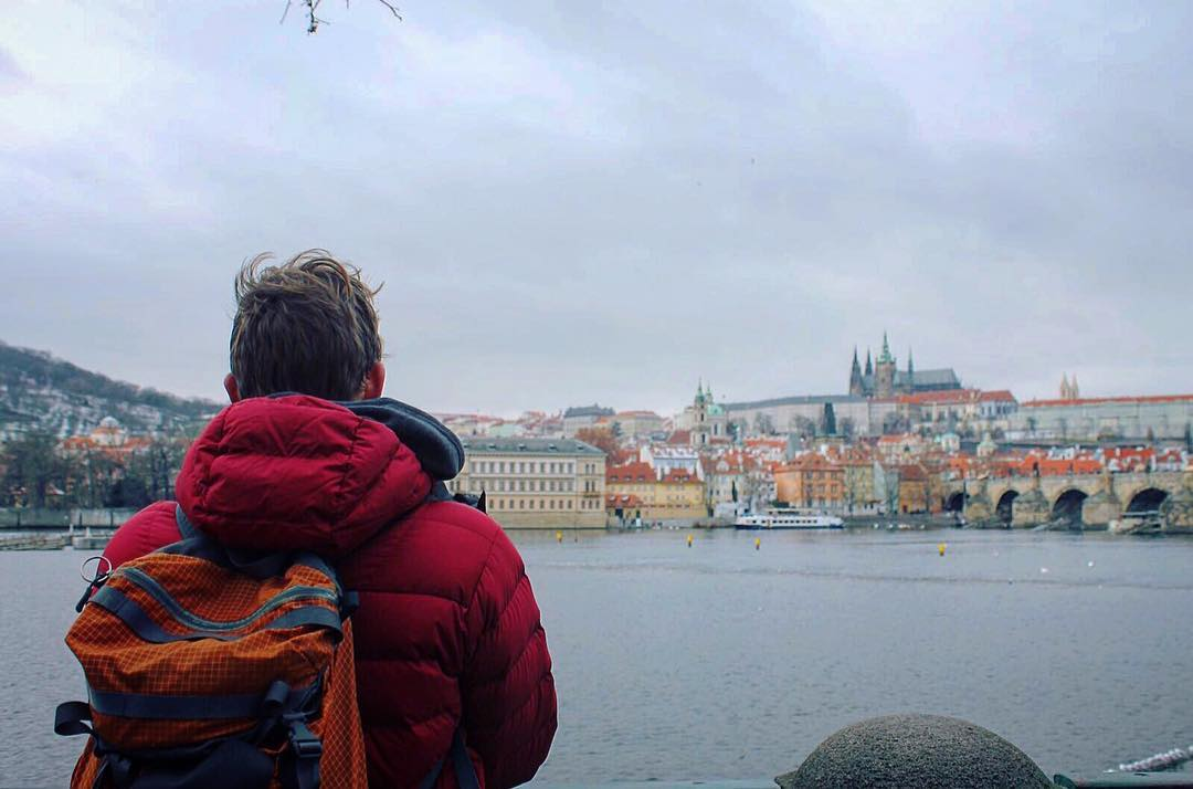 Boy with red jacket in Prague