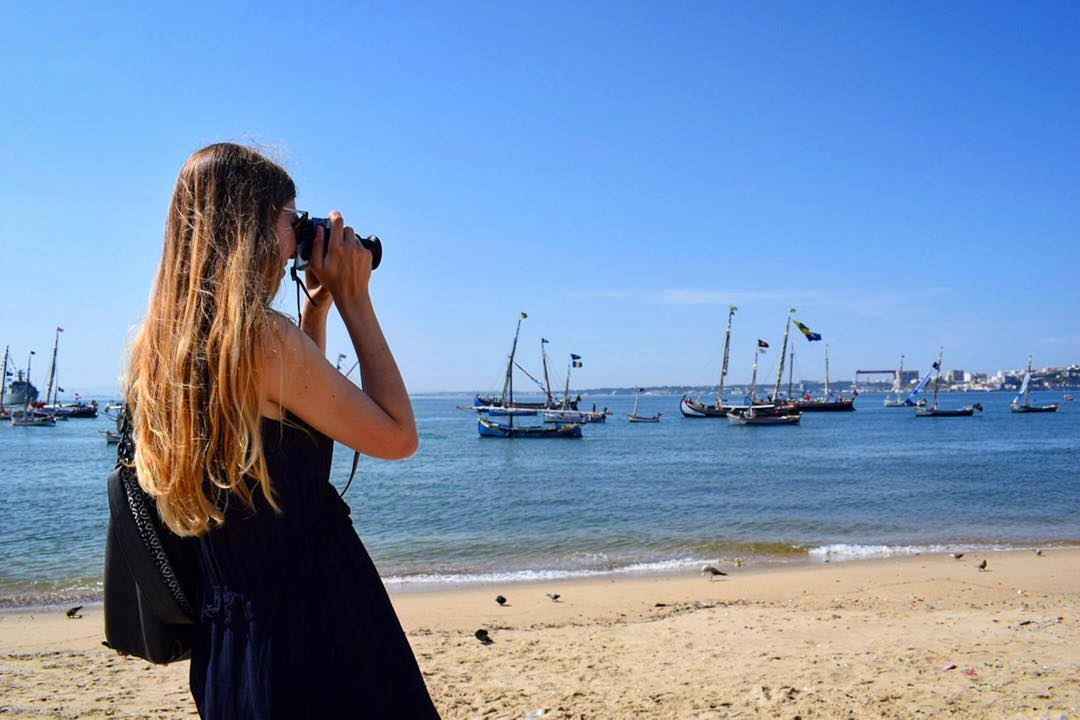Woman taking photo in Lisbon Portugal