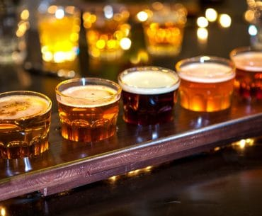 beer glasses in wooden sample board at bars and pubs in edinburgh