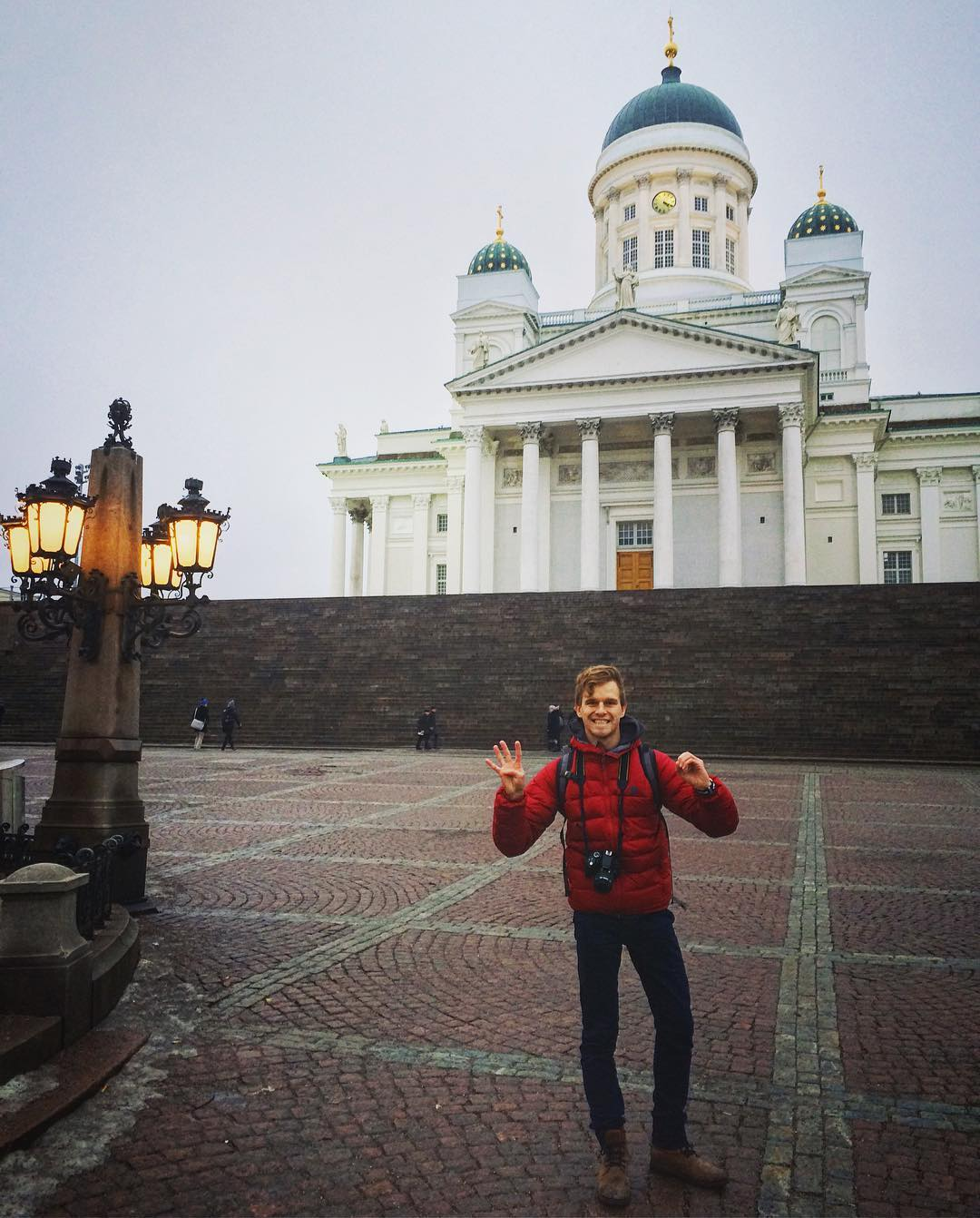 Man with red jacket in Helsinki Finland