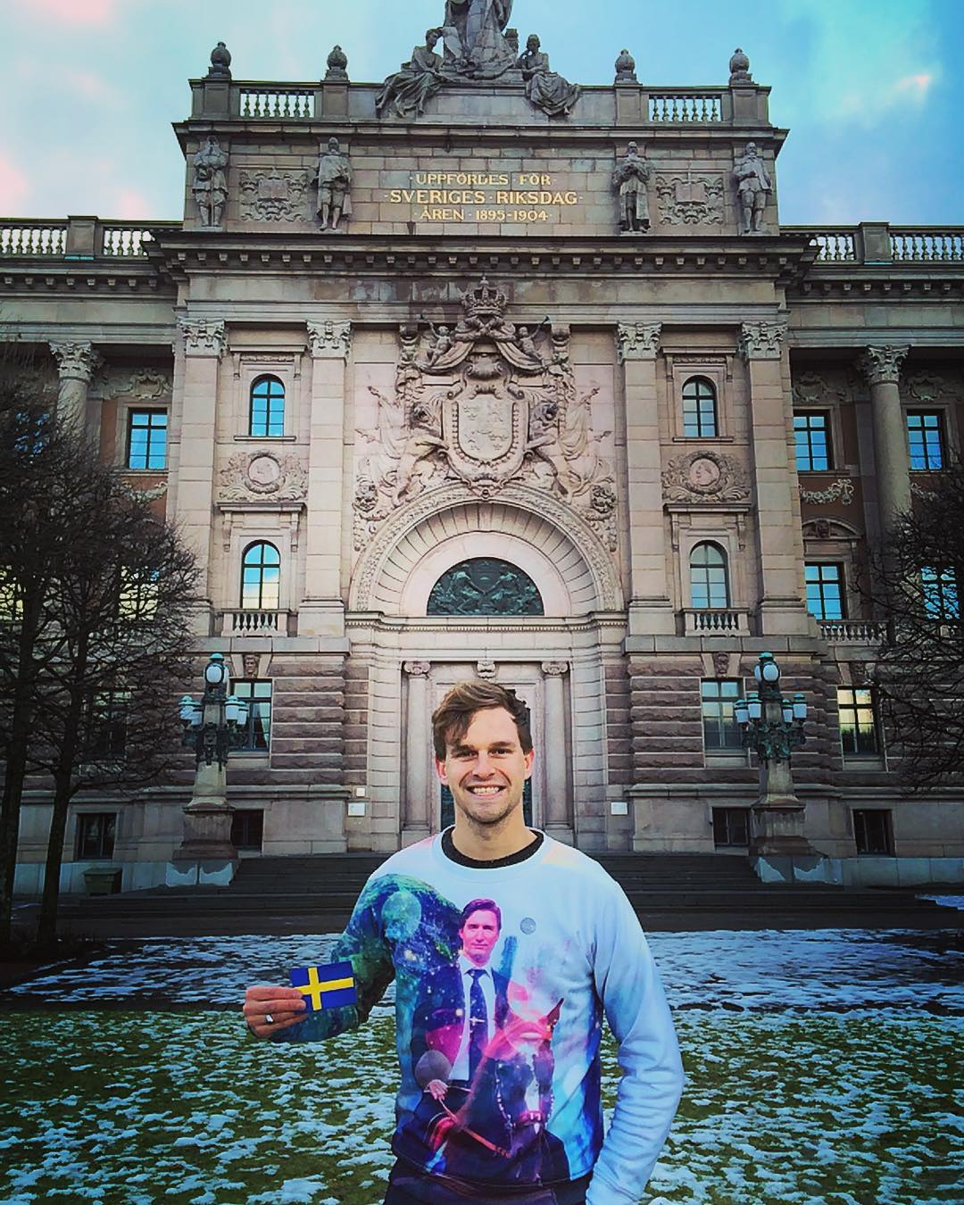 Guy with Swedish Flag in front of old building Stockholm