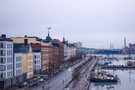 finland buildings on waterfront with boats nordic capital
