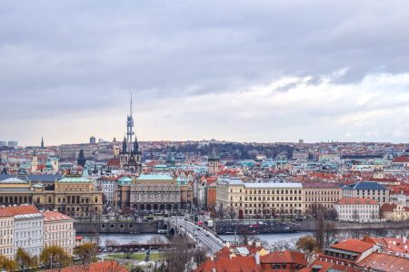 colourful city buildings with river from above things to do in prague
