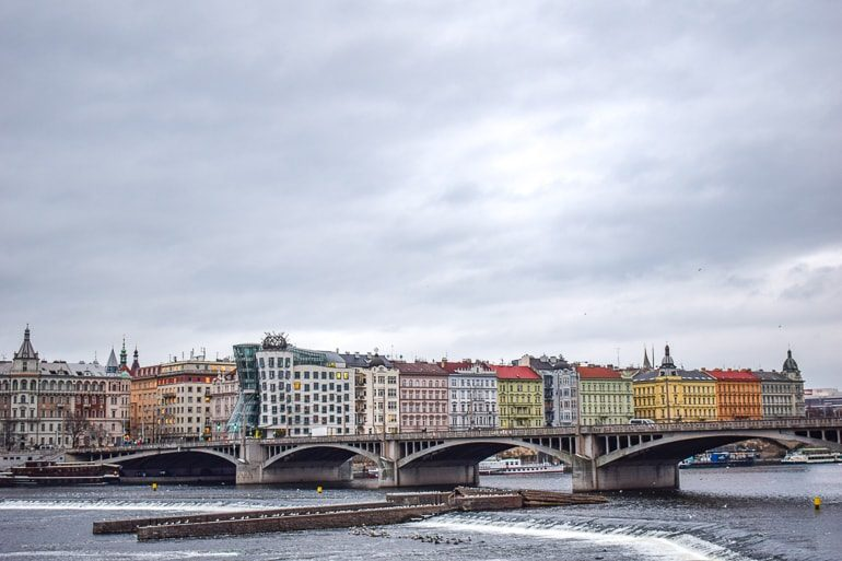 colourful houses with bridge over river things to do in prague