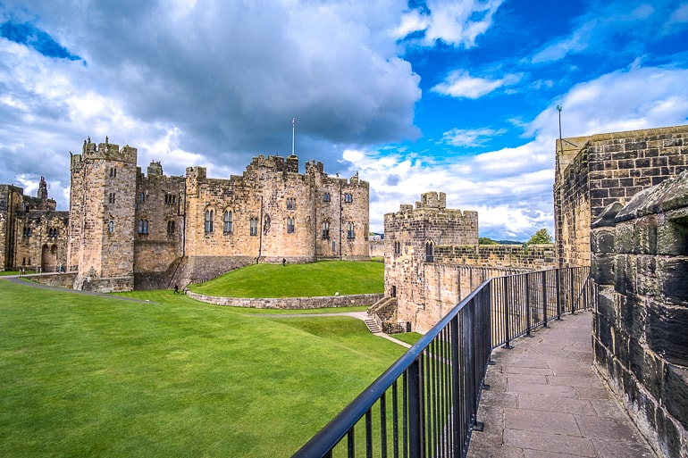 old castle with walking path and green grass alnwick castle