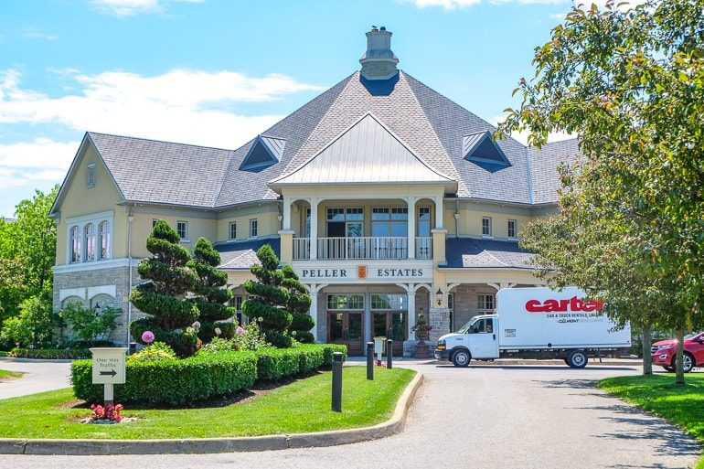 large building with delivery truck in front and green gardens peller estates
