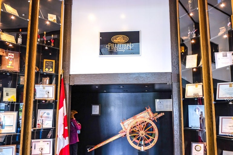 wooden cart with glass cases around in winery entrance niagara on the lake