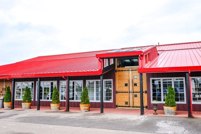 red tin roof on roadside building with wooden door niagara on the lake winery