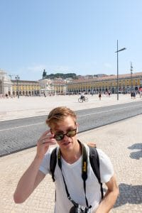 boy taking off sunglasses in lisbon portugal