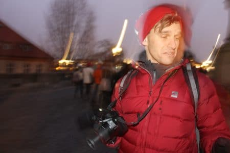 boy with red jacket and camera at night
