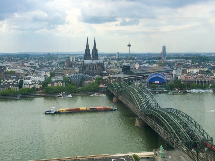 cologne cathedral and river with bridge europe trip itinerary