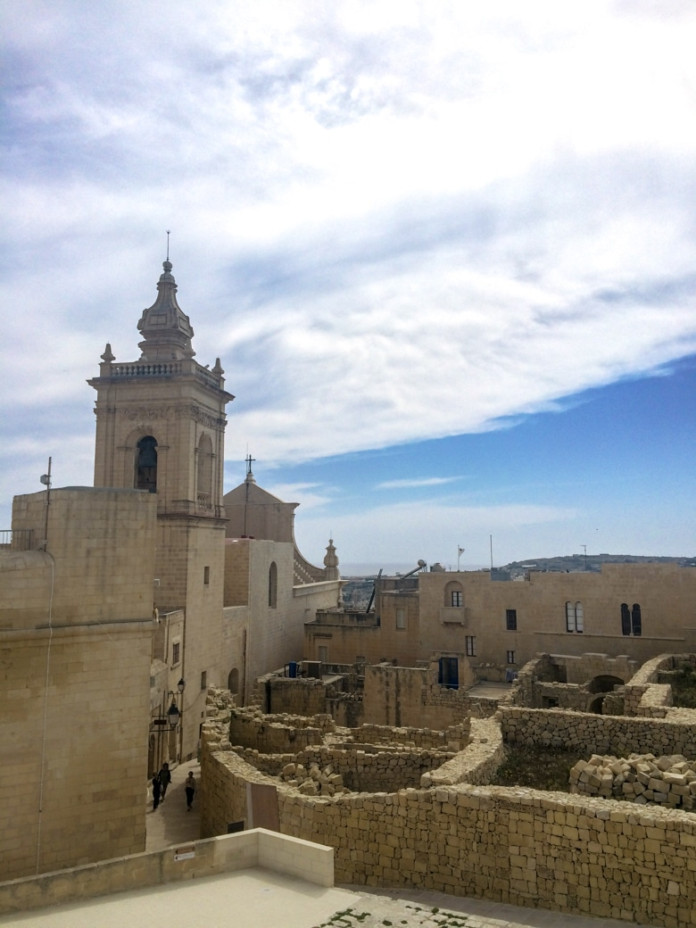 old sandstone citadel in malta with blue sky