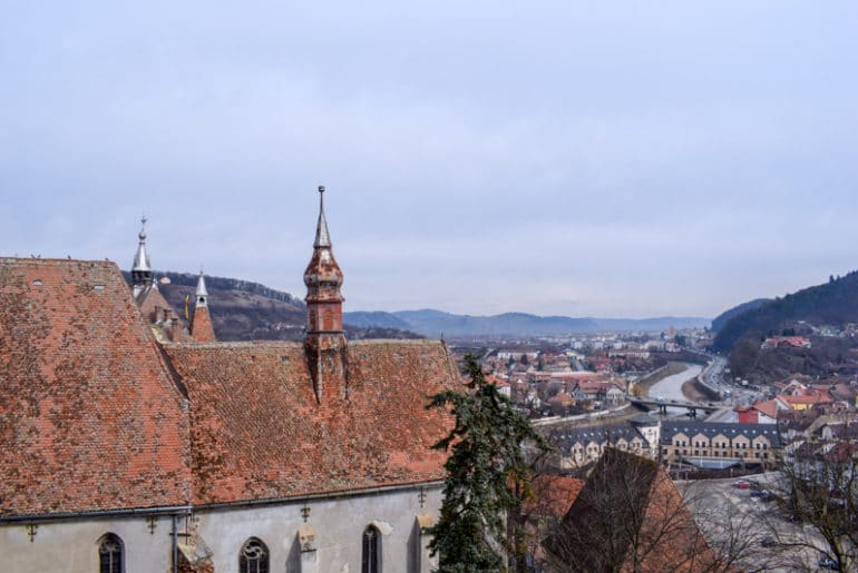 church with orange tiles and view of sighisoara romania