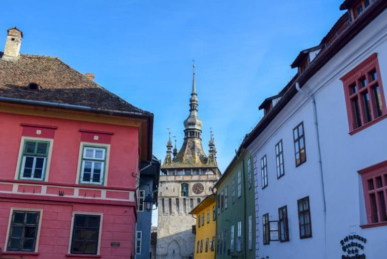 sighisoara tower with colourful houses