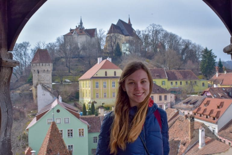 girl posing with church in the background