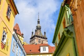 colourful rooftops with clock tower sighisoara romania
