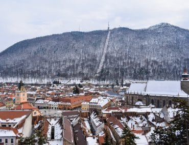 old town brasov red roofs with snow high vantage shot