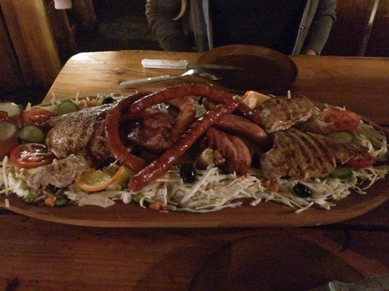 meat and food platter on wooden table bucharest romania penguin and pia