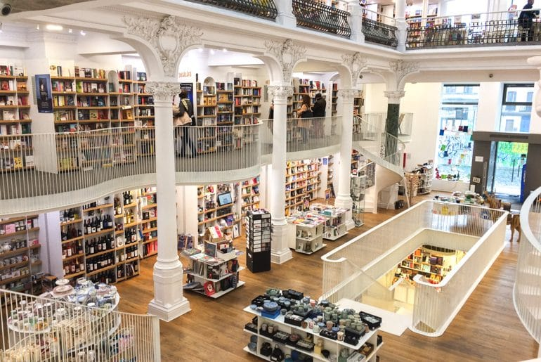 white bookshelves and bright store in places to visit in bucharest romania