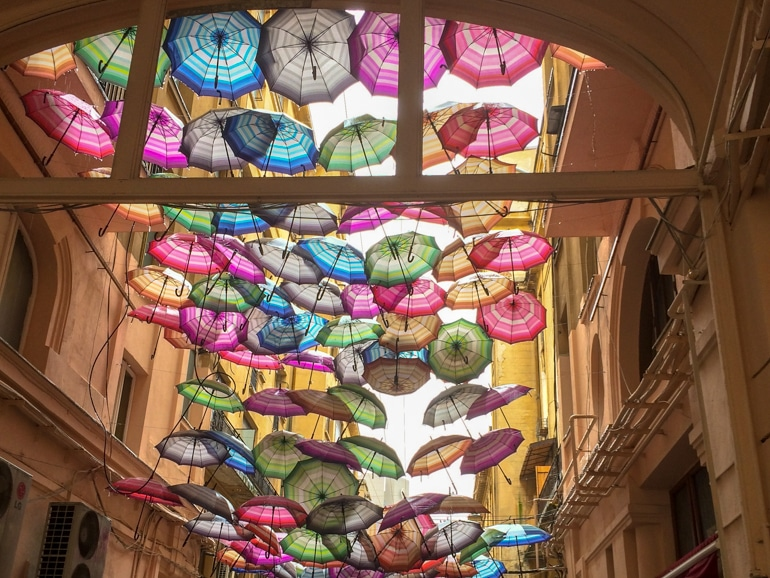 colourful umbrellas hanging in alley in bucharest romania