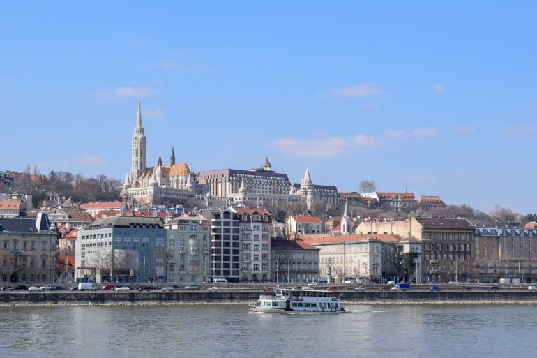 boat on the river danube with building on river bank