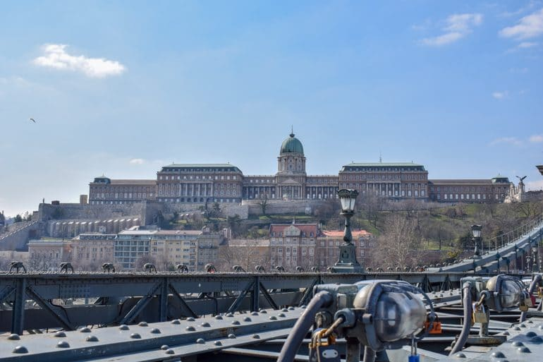 buda castle with love locks in front on bridge