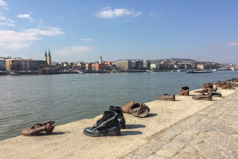 shoes facing the river edge what to do in budapest hungary