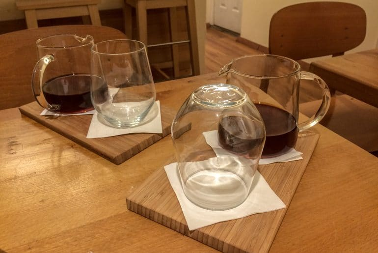 coffee and glasses on wood platters best cafes in budapest