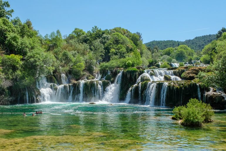 waterfall with green trees in krka national park on day trips from split