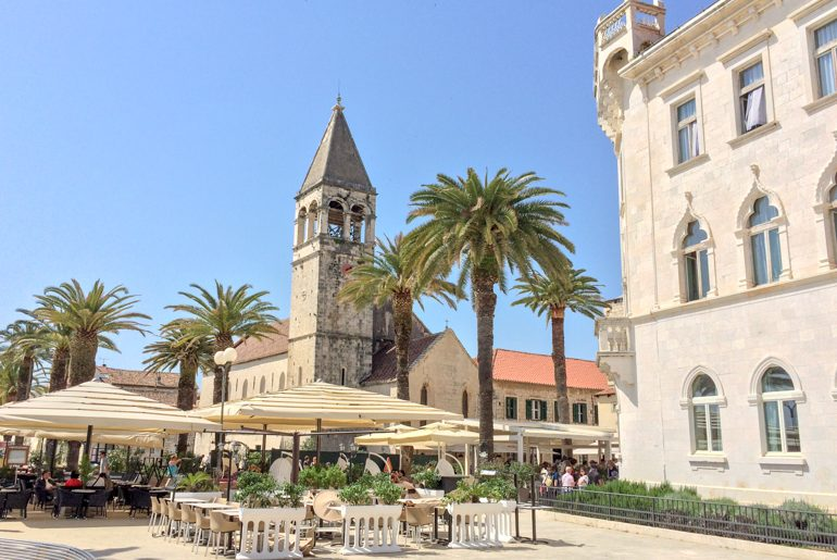 old town tower with restaurants on trogir on day trips from split