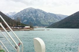 mountain and water view from bus door in montenegro to croatia
