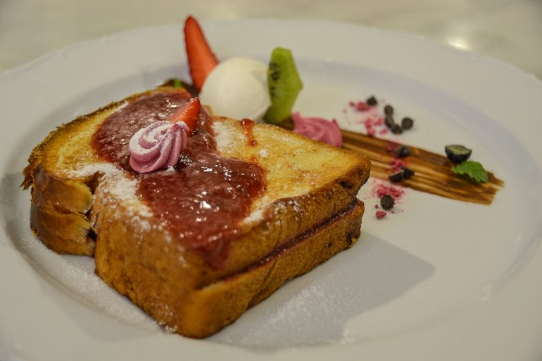 french toast on white plate top restaurants in budapest