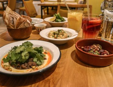 dishes with food on wooden table in budapest