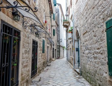 cobble stone and rock old town alley after bus from dubrovnik to kotor