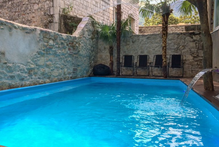 blue water in hostel pool in old town kotor things to do in kotor