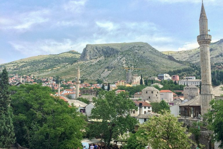 mosque towers and old town with blue sky in mostar things to do in mostar