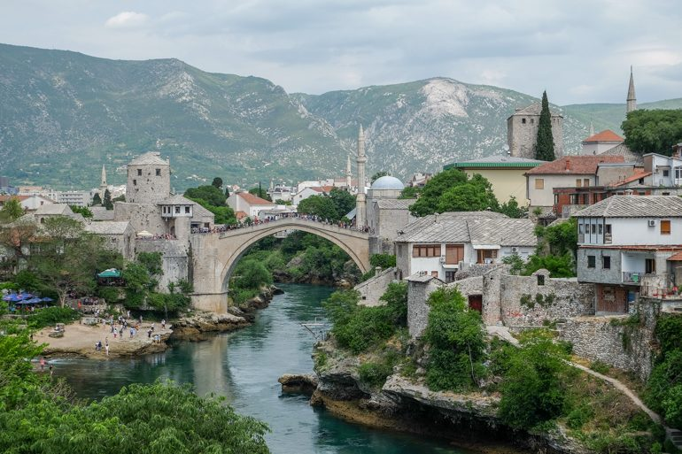old town mostar with old buildings are blue river below things to do in mostar