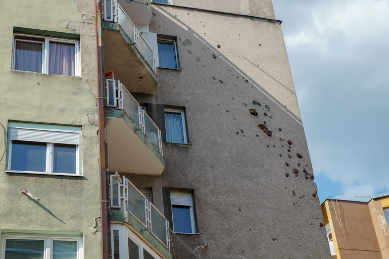 apartment building in sarajevo with shrapnel holes