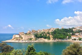 old town pier with blue cove and blue sky above in ulcinj montenegro