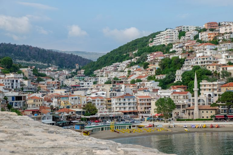 sandy beach with many buildings facing bay in ulcinj montenegro