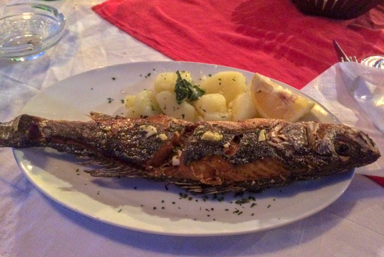 crispy cooked fish on plate with potatoes things to do in ulcinj