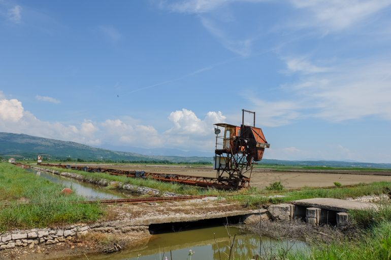 rusted machinery in green salt flats things to do in ulcinj