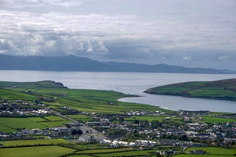 small houses with green hills and coastline ireland travel tips