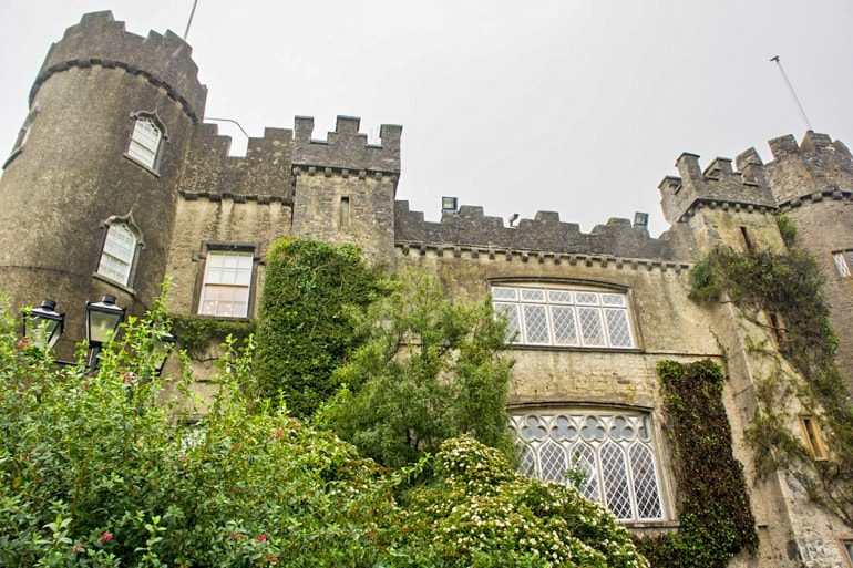 castle with turrets and green trees ireland travel tips