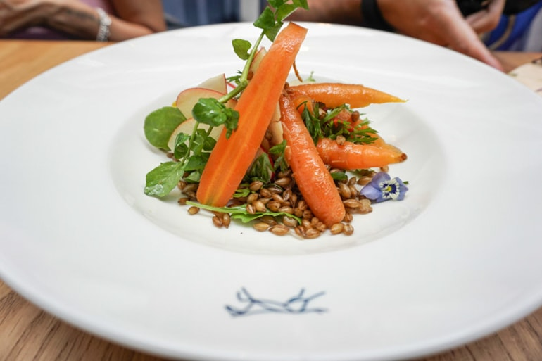 carrots and food on white plate ireland travel tips