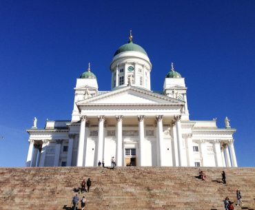 helsinki cathedral and steps with blue sky in background one day in helsinki