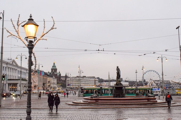 market square in helsinki with fountain and harbour cand street light post one day in helsinki
