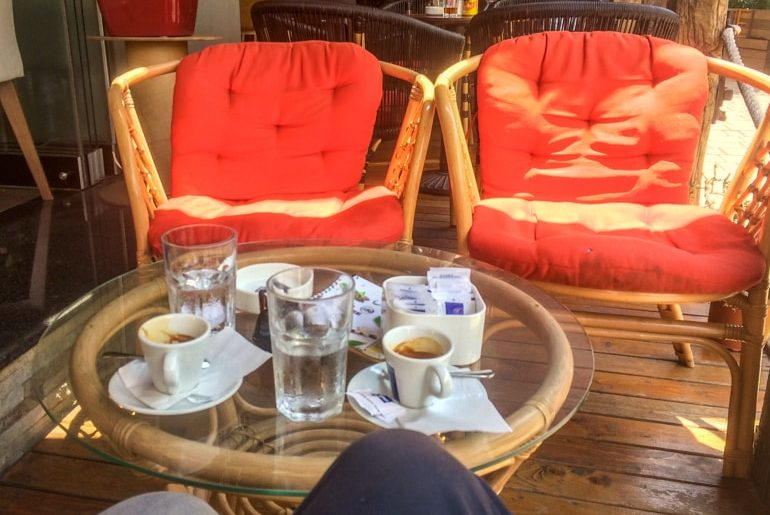 red chairs and coffee cups at cafe places to visit in tirana