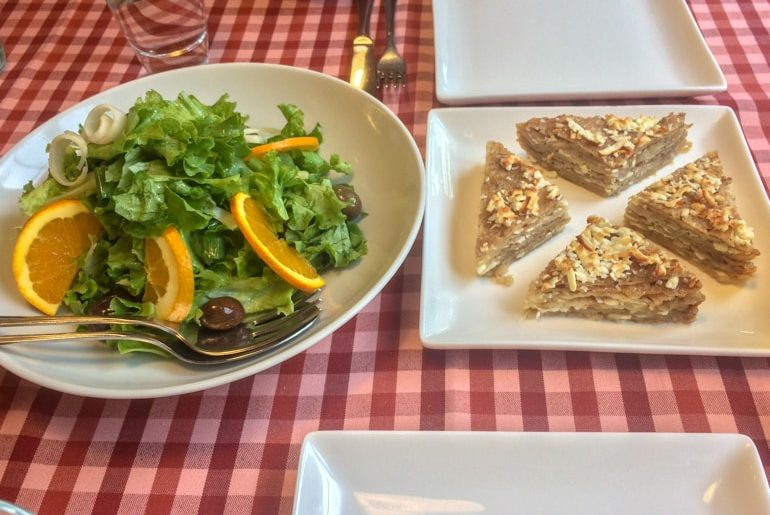 salad and crepes on plates in red table cloth places to visit in tirana