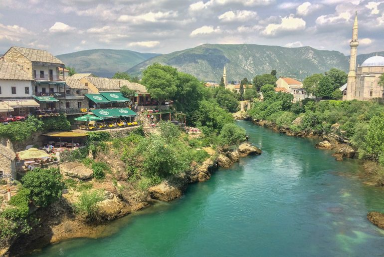 shops along river bank of blue river in mostar bosnia and herzegovina travel